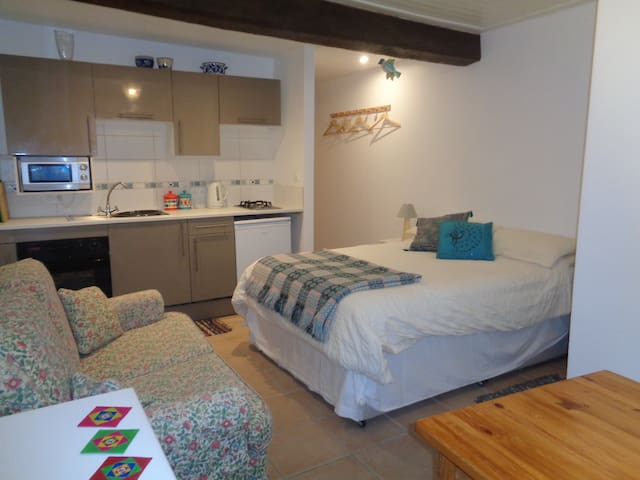 The Studio -  with double bed, sofa, table and kitchen area