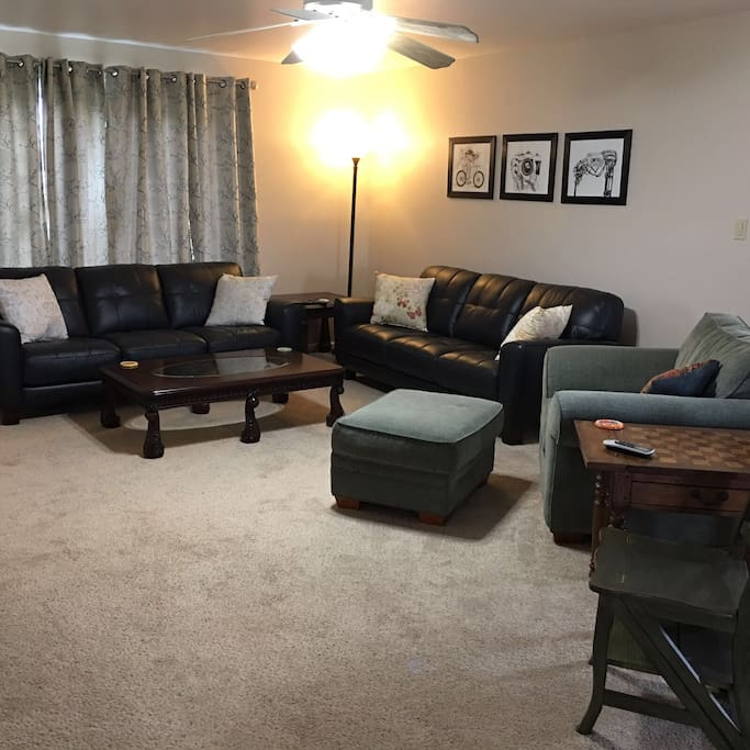 A large living room with comfortable seating and a flat screen tv.