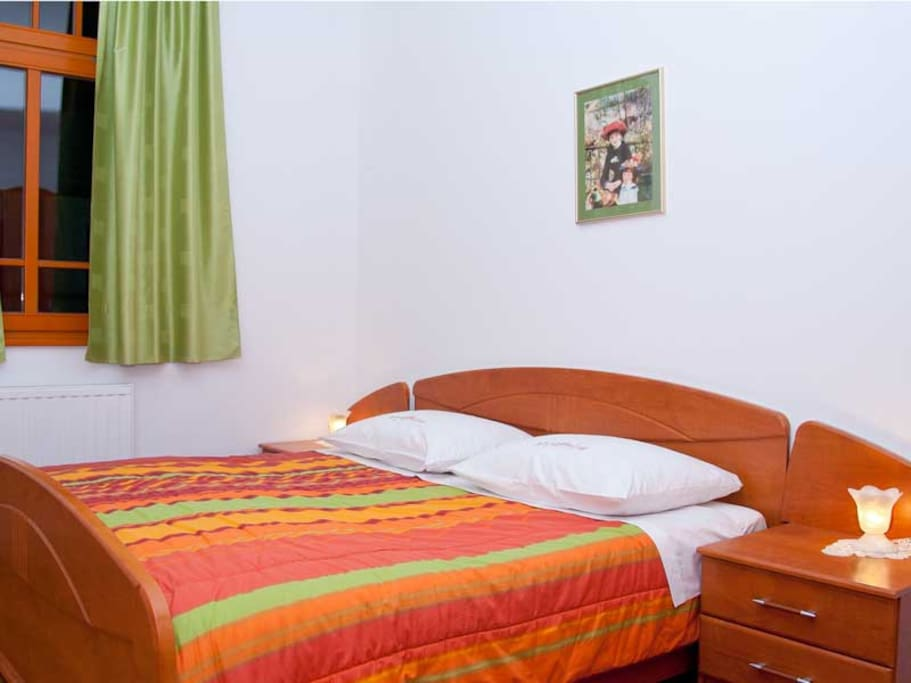 Bedroom with double bed in Apartment Rombon