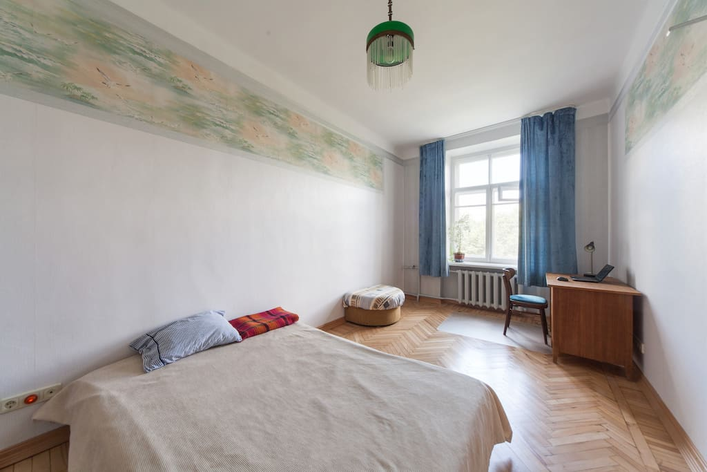 Spacious quiet room in an Moscow center with sofa, table and clothes rack close to metro Taganskaya