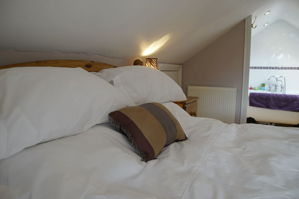 Comfortable double bed, with ensuite roll-top bath for a little extra luxury.