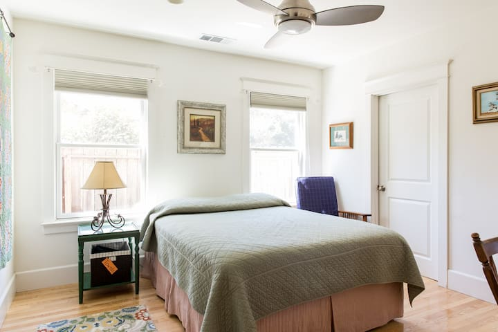 The guest room with a comfortable queen size bed with a pillow-top mattress.