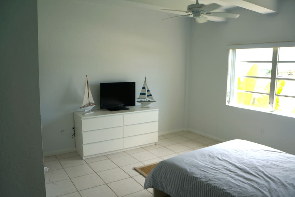 Large bedroom with double bed, ensuite bathroom, tv and walk in closet.