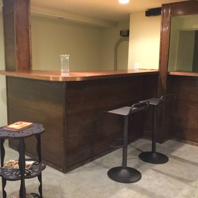 Clean bar with adjustable bar stools for eating and casual sitting