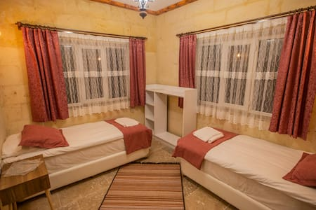 in this room we have 2 single bed and 1 french bed but if you want it can be changed to the 4 single bed.