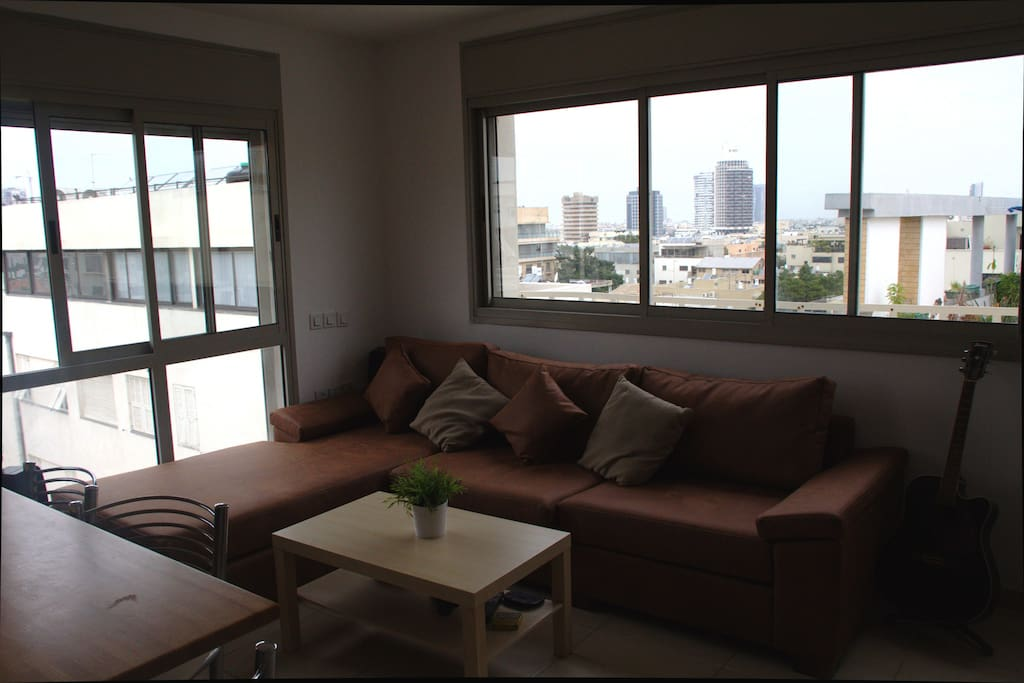 Shared living room. Has TV and home theatre and a wonderful view of Tel Aviv.