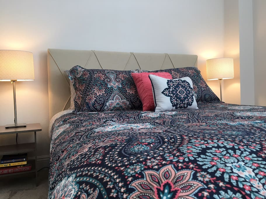 Set with a queen size bed, dressed with contemporary bedding and matching pillows for stylish sleeping,  enjoy pure relaxation in this luxurious master suite which also includes a master bathroom.