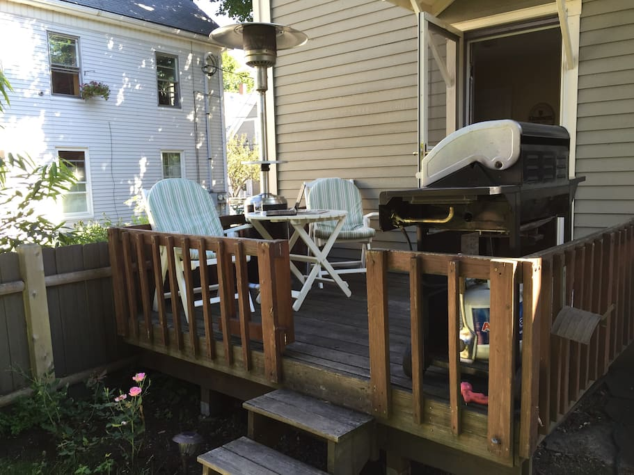 Private back deck with Weber grill