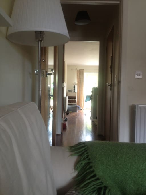 View from sitting room leading to down stairs toilet & kitchen / dining area & back garden