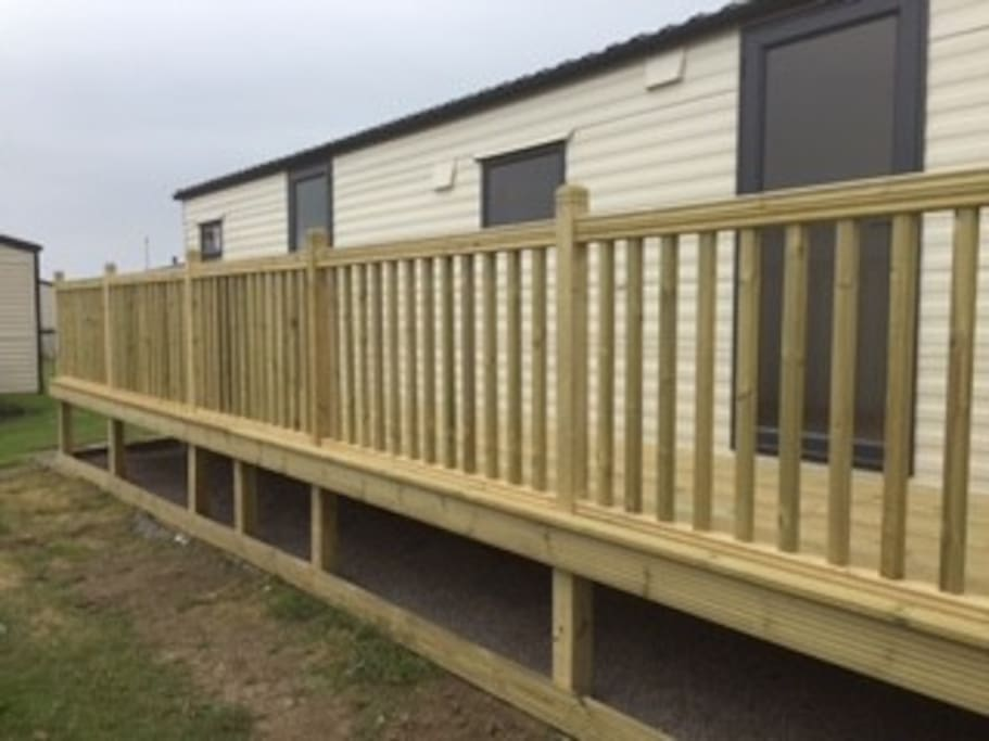 The decking is 35 ft long running entire length of caravan with a gate at one end to stop little ones escaping....