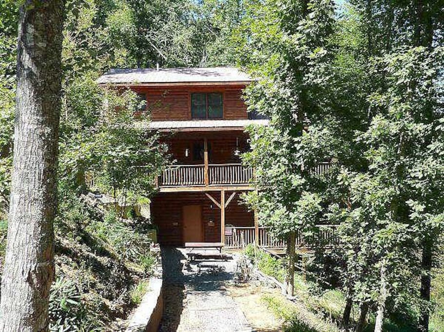3 story log home on acre of private property