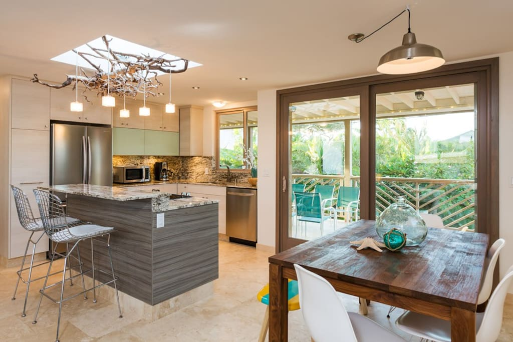 Upper level Full kitchen with partial ocean view