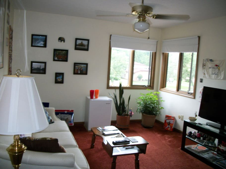 """Well lit private sitting room next to bedroom with 40"""" TV with cable/Netflix, sofa and a mini-fridge"""
