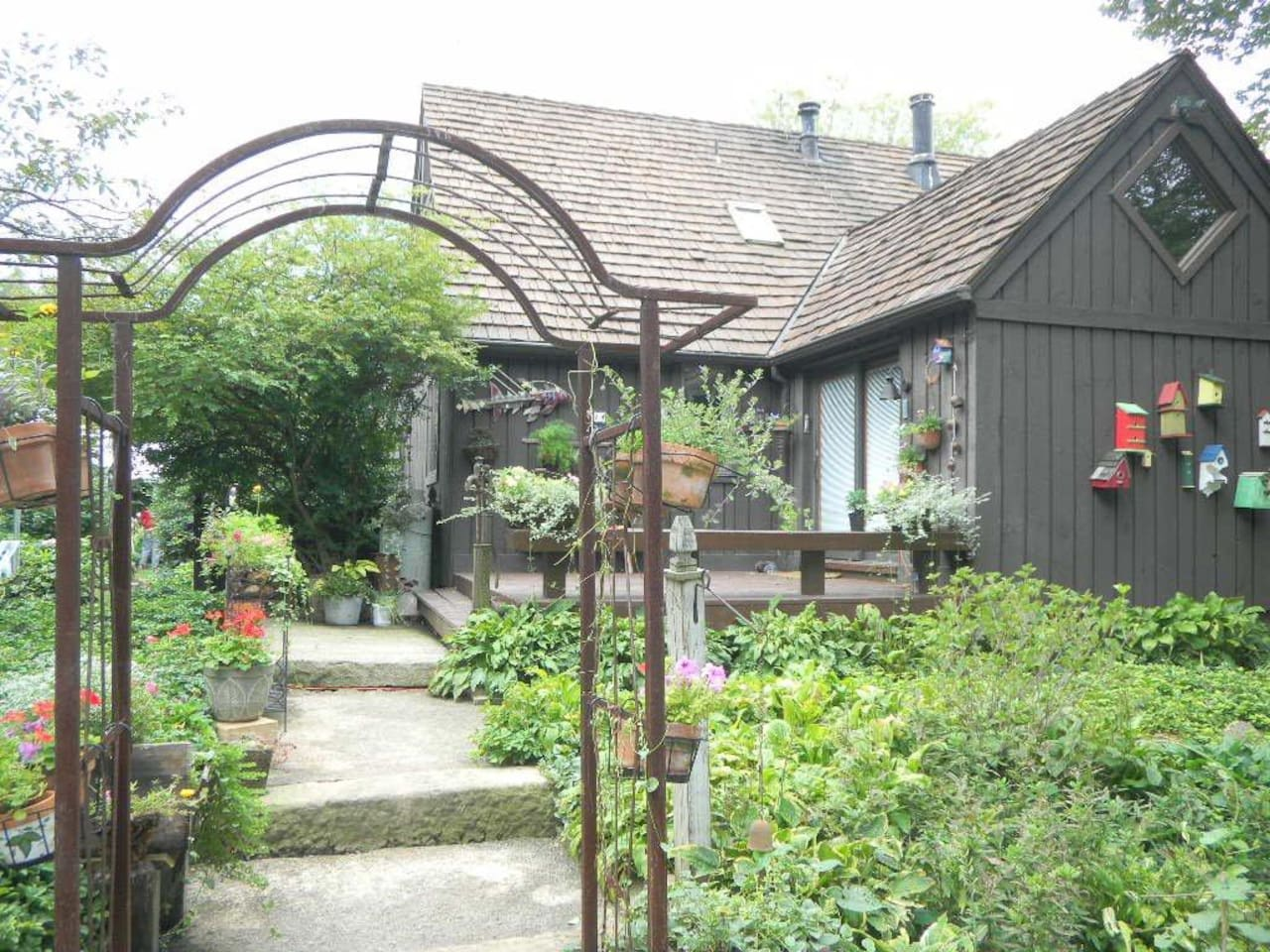 Front entrance of the rustic, charming house and gardens.