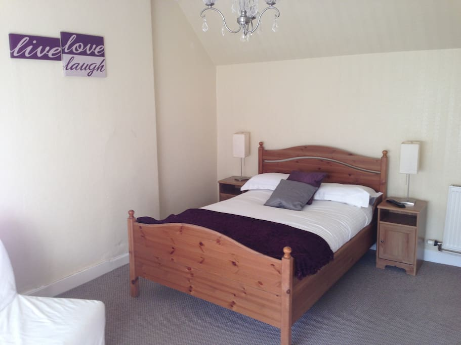 En-suite double room with optional fold out double bed with bath.