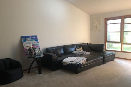 Open concept condo with garage and yard