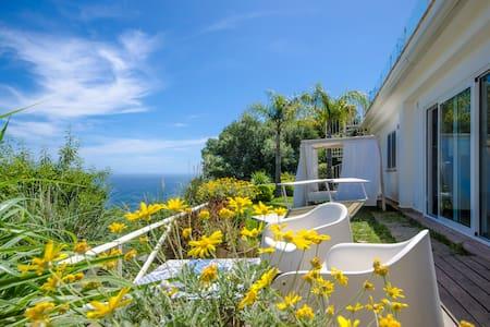 Amazing sea view apartment, private garden & pool