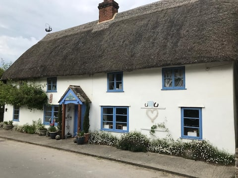 Artistic and Unique Thatched Cottage