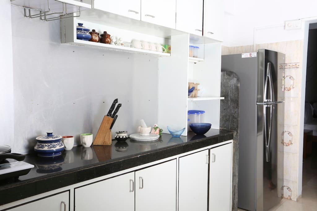 Fully functional kitchen with all appliances to whip up something delicious even while youre away from Home.