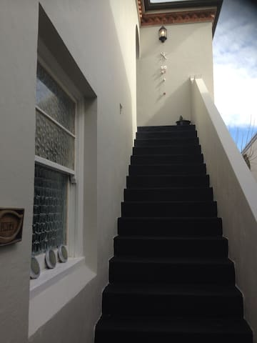 Private entrance - follow stairs up to your apartment