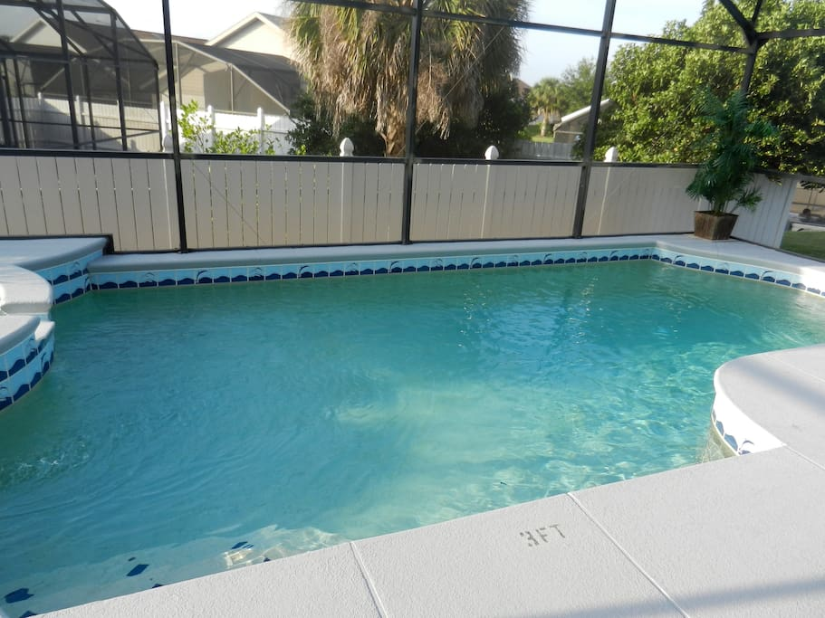 Inviting screened in private pool with hot tub. Pool/Spa heat extra.