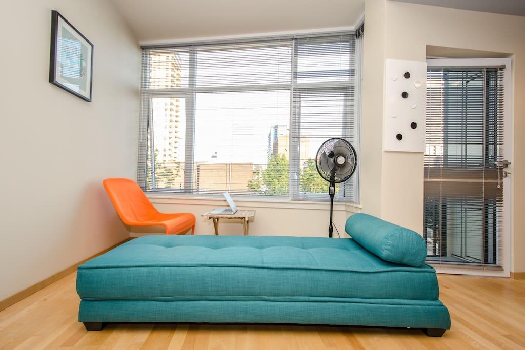 Modern, comfortable living area! The futon folds out to a full size bed.