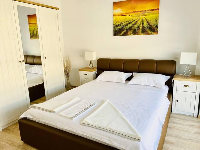 Queen size bed with premium memory foam mattress.
