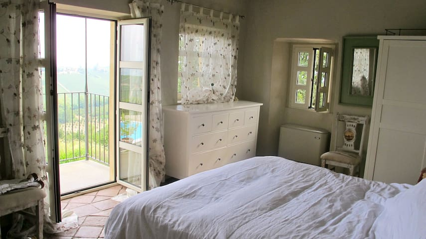 Upper master bedroom with private bath and balcony