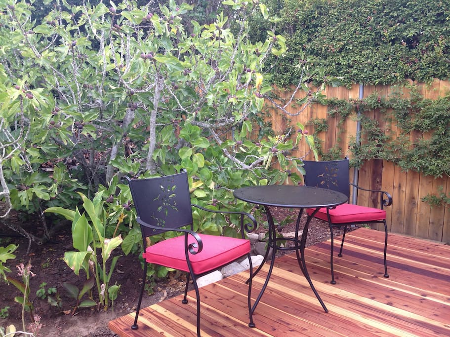 Deck with cafe table in garden setting