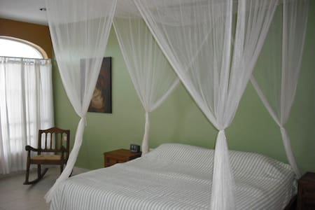 Centrally located in Puerto Morelos, steps to the beach, and 4 blocks to town. The house is tastefully decorated in Mexican Rustic furnishings. Loaded with comforts and amenities, an excellent value for large extended family gatherings.