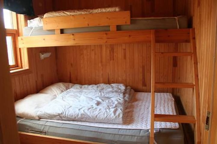 Each room has double bed and Single bed above
