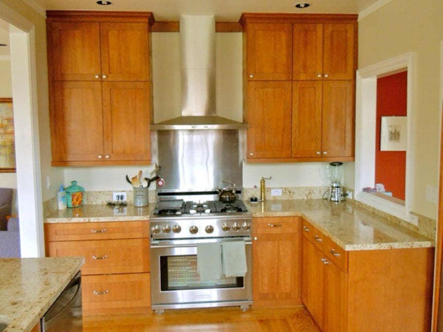 New kitchen with 6-burner stove, stainless steel appliances, marble counters