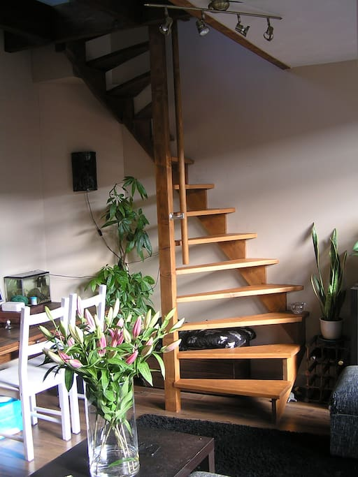 Dining corner and spiral staircase up to study and terrace!