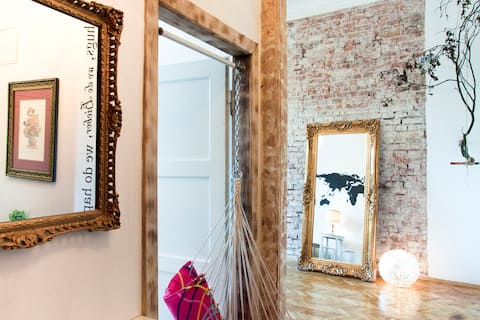 Entrance door to the smaller room (left) and mirror in the larger room (right)