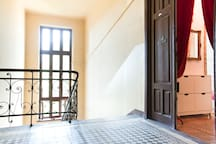 Main staircase and the apartment's entrance door