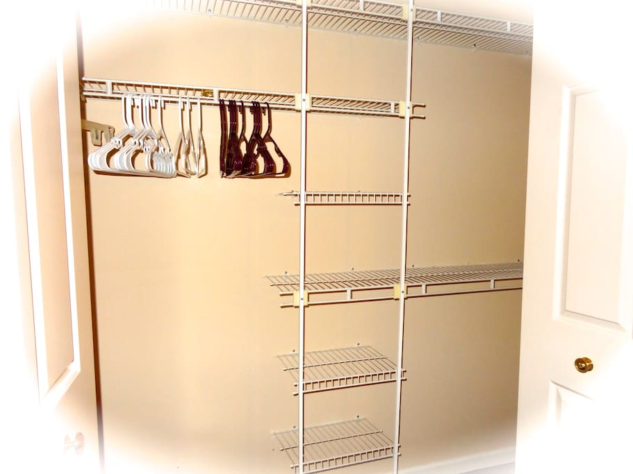 spacious closet space with shelves and hangers