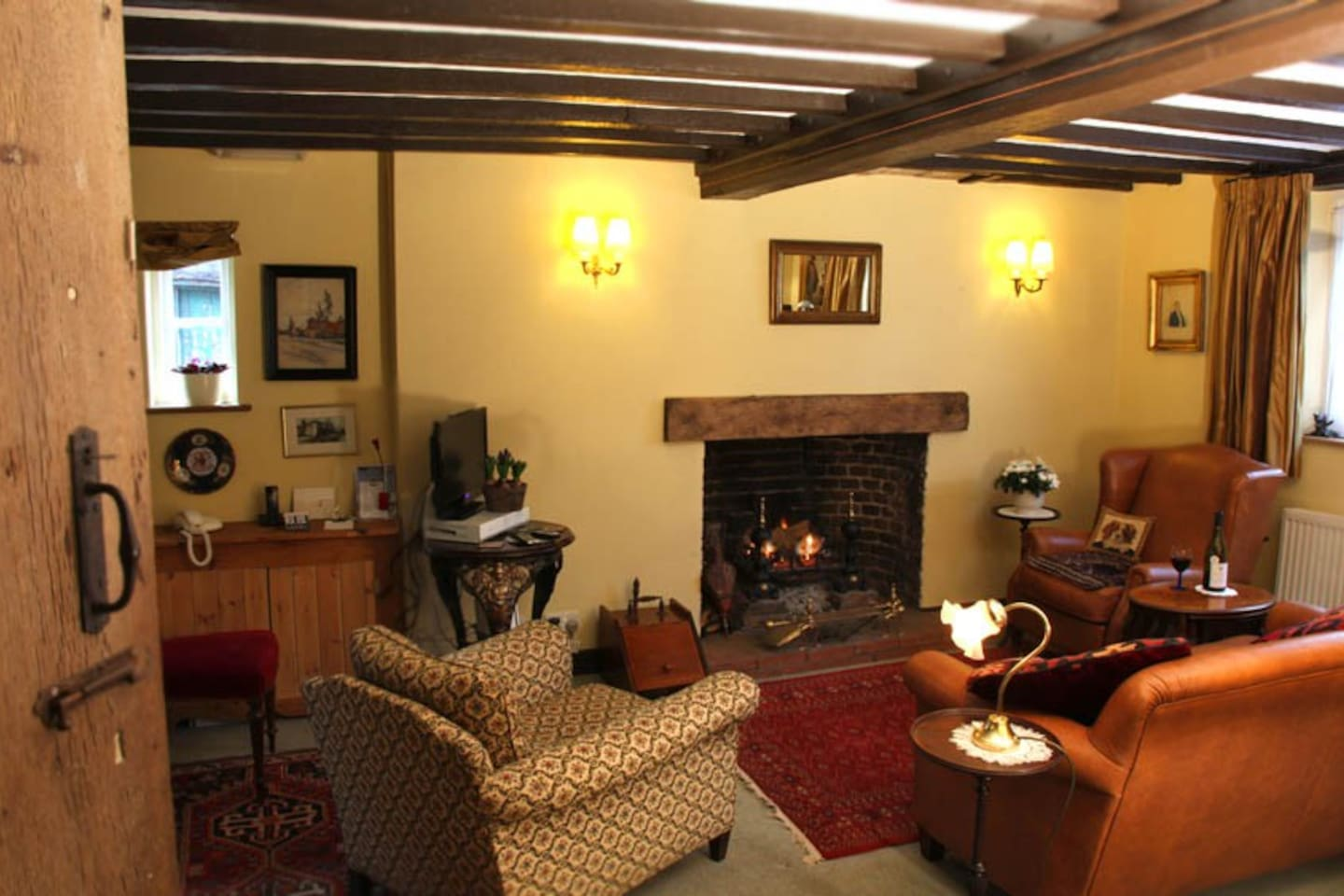 Sitting room at the Pilstyes, 106 High Street, Lindfield with open fire