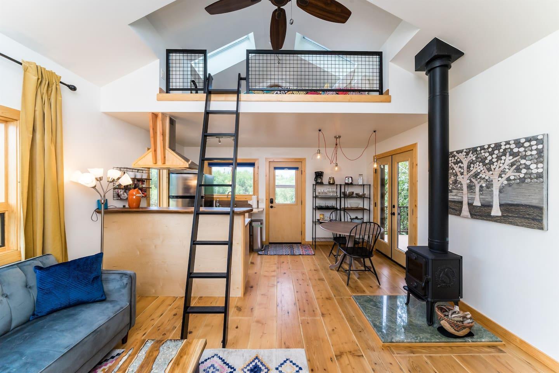 Charming modern farm home with skylight sleeping loft.