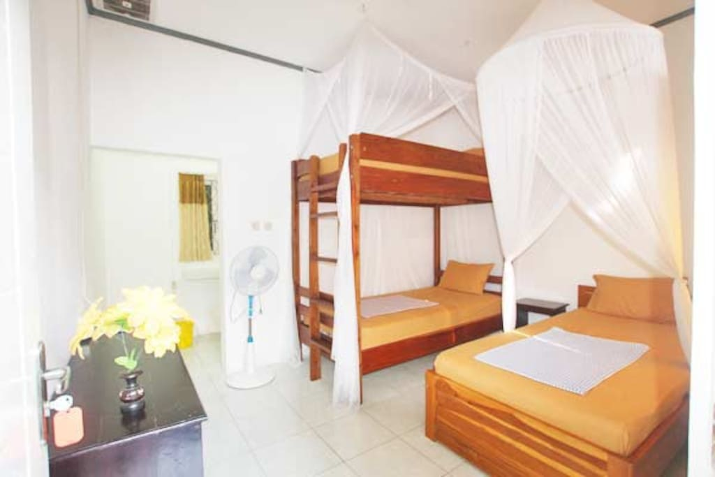 Single bed room with 3 single beds