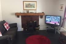 Snug living room with wood burning stove