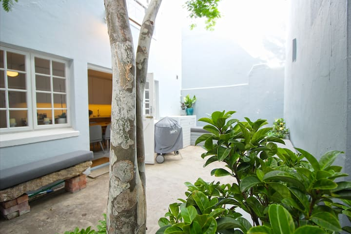 Spacious back courtyard area with bbq and outdoor shower