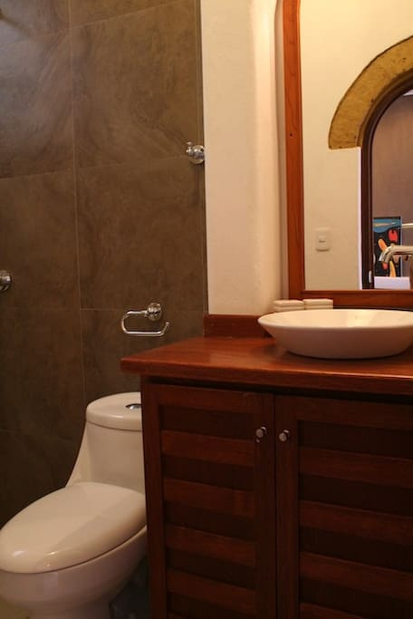 Bathrooms are elegant, tiled and completely new.