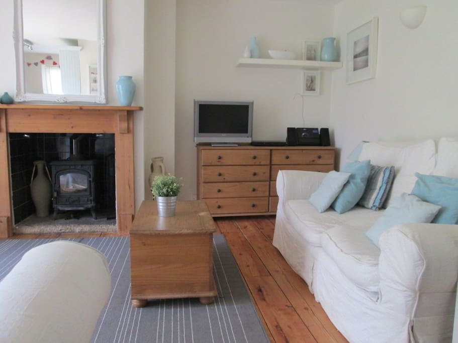 Living space with one of two settees, TV, DVD, iPod station etc