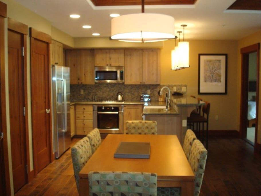 Gourmet kitchen, granite countertops, , high-end stainless steel appliances.
