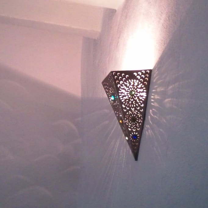 Hand crafted wall sconces from San Miguel for warm lighting in living/dining area