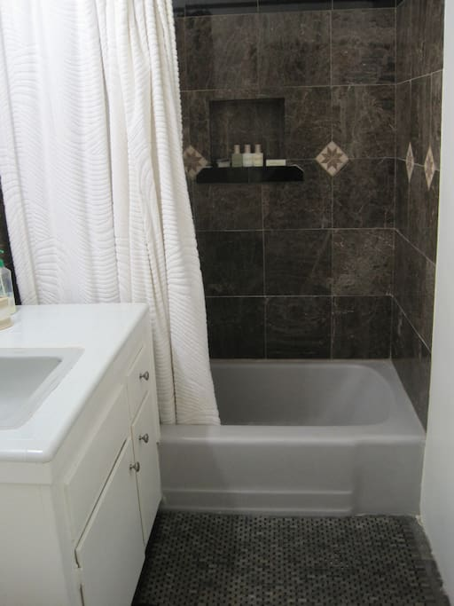 Big Bathroom with toilet/sink/shower/bath.  We provide fresh towels & toiletries.