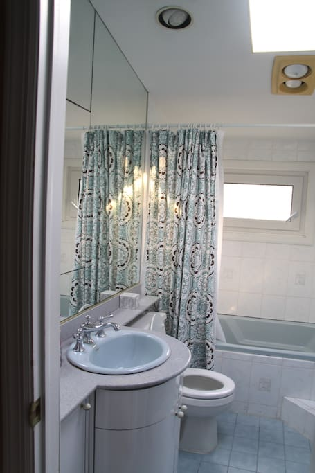 The upstairs bathroom contains a heat lamp, a skylight, and brand new water-saver toilet!
