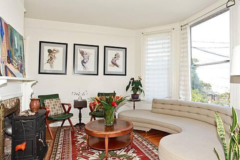 Living room w mid-century modern furniture and original art.