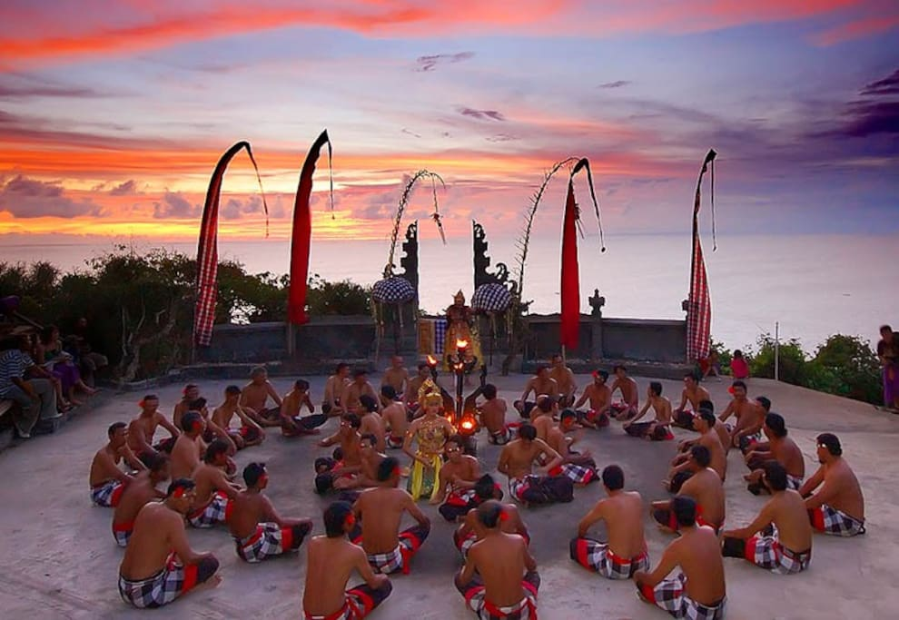 The performance of Kecak fire dance at Uluwatu temple during the sunset.