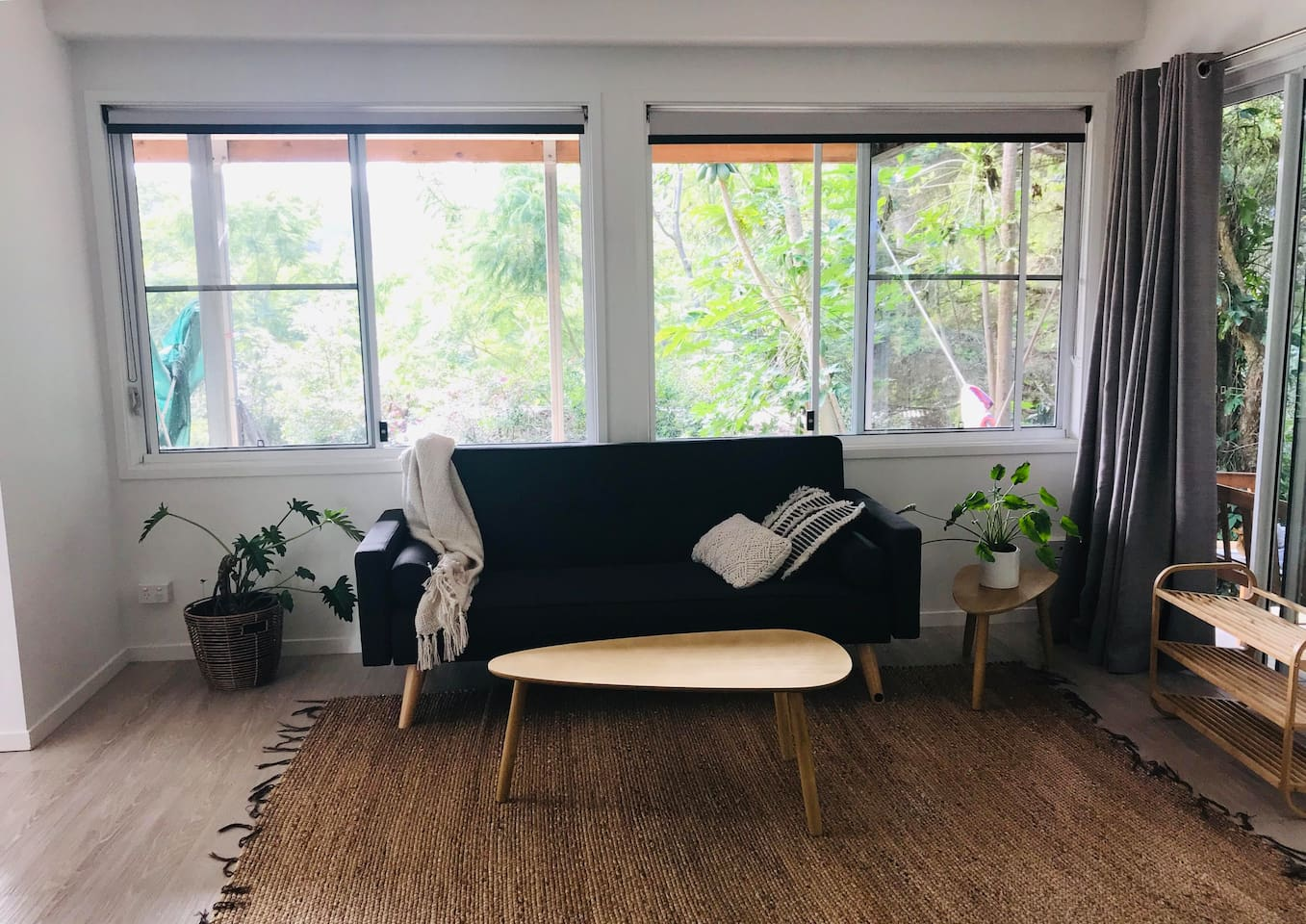 Clean bright open plan lounge area with a beautiful bush background-It is hard to believe you are in  Suburbia